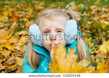 girl in autumn showing silence - stock photo
