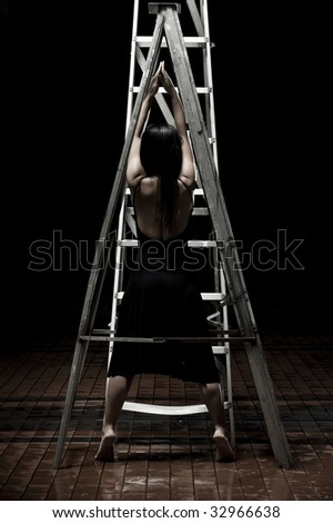 girl in black dancing on a ladder