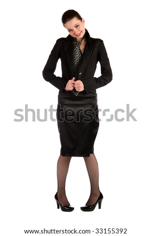Girl in black suit hiding her necktie. Isolated on white.