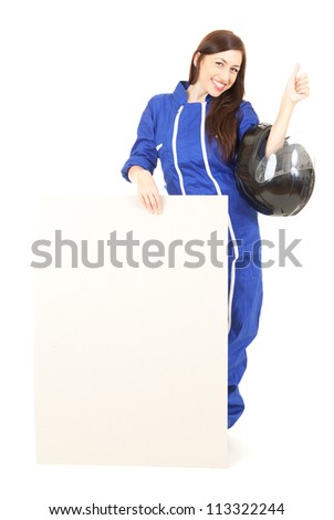 girl in blue motorcycle clothing holding helmet, white board and thumb up, white background - stock photo