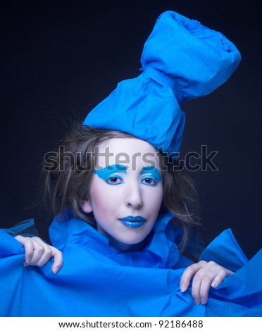 Girl in blue. Young woman in artistic image with bright visage and in blue hat. - stock photo