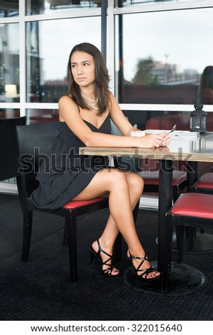 Girl in cafe waiting