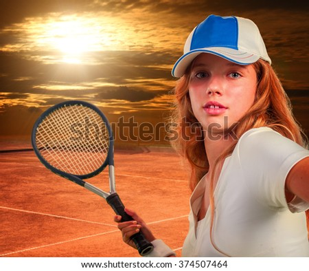 Girl in cap holding tennis  racket on sun sky with clouds. - stock photo