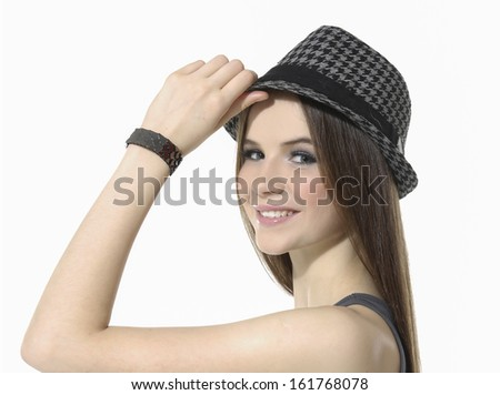 Girl in cap isolated on white. Focus on eyes