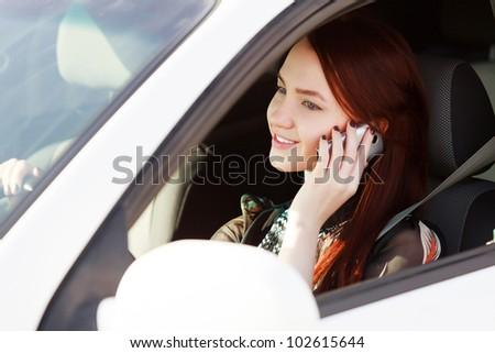 Girl in car - stock photo