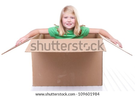 girl in cardboard box, on white background