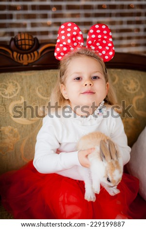 Girl in Christmas costumes with rabbit