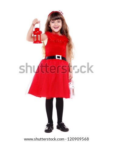 Girl in Christmas dress holding candle lantern in her hand isolated on white background - stock photo