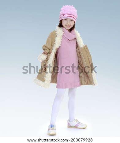 girl in coat and red hat.new year, warm clothing,happiness concept,happy childhood,carefree childhood,active lifestyle