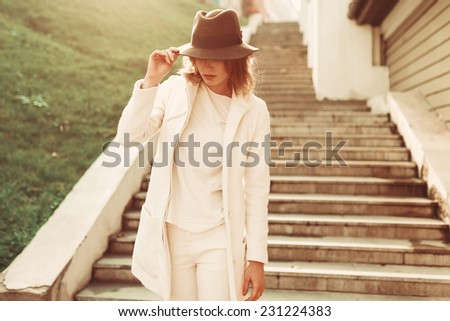 Girl in coat in the sun Posing