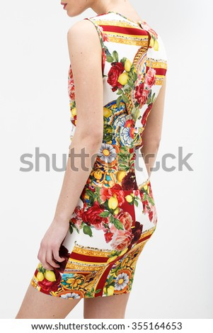 Girl in color summer dress on the white background