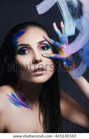 girl in colorful paints