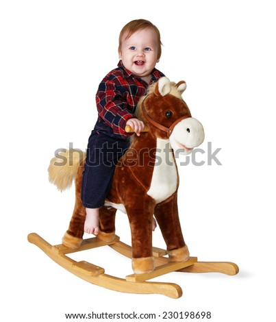 Girl in cowboy clothes and a straw hat sitting on a toy horse, isolate - stock photo