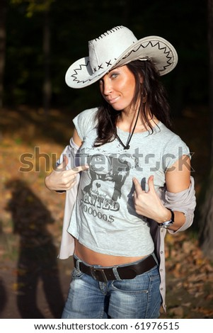 Girl in cowboys hat and handmade shirt - stock photo