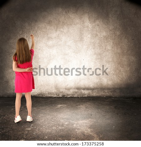 girl in dark room and red dress  - stock photo
