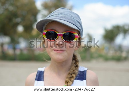 Girl in denim hat and sunglasses