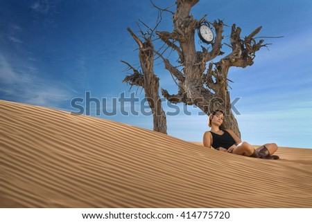 Girl in Desert with Clock