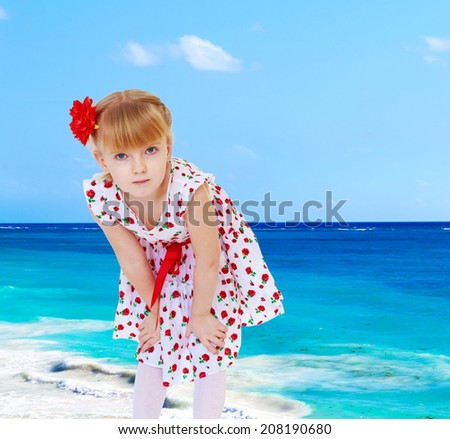 Girl in dress against the sea.the concept of childhood and joy, teens - stock photo