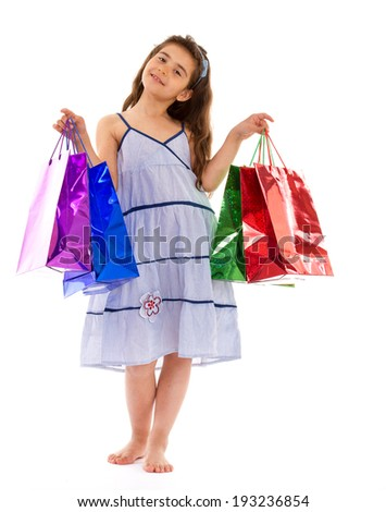 Girl in dress with colorful packages