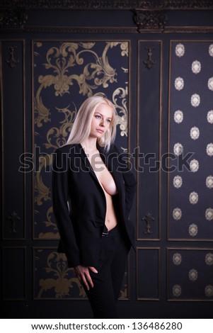 Girl in elegant black costume, studio shot - stock photo