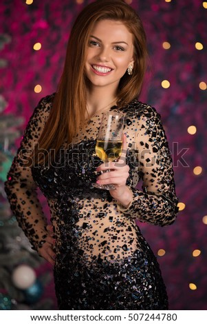 girl in evening dress with champagne glasses - new year, celebration