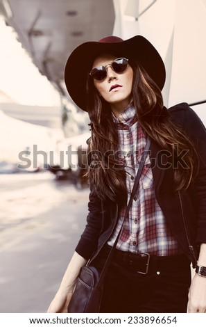 Girl in fashionable look on a city street. Fashion style - stock photo