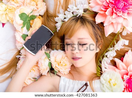 Girl in flower good sleep with phone
