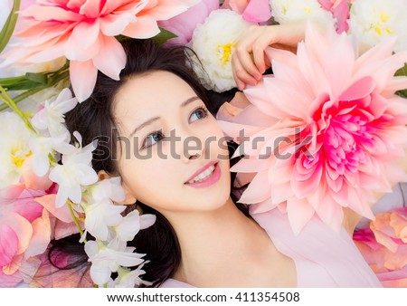 Girl in flower smile SPA - stock photo