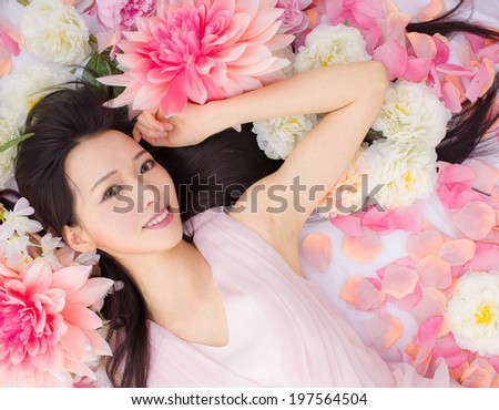 Girl in flowers health - stock photo