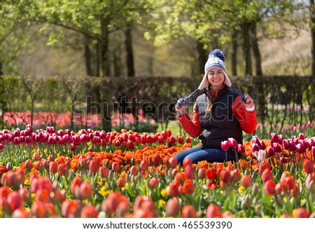 Girl in Flowers in the park Keukenhof in the Netherlands.