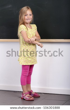 girl in front of a chalkboard - stock photo