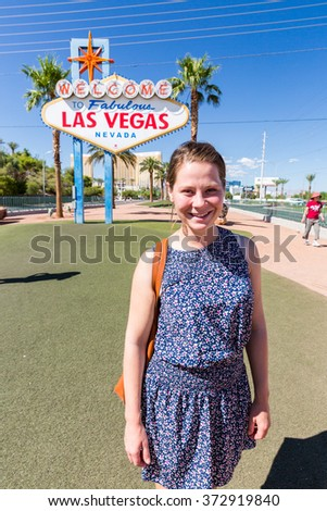 Girl in front of the Welcome to Fabulous Vegas sign - stock photo