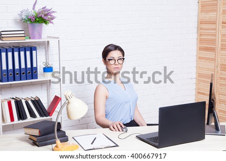 girl in glasses with a folder in Office