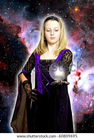 girl in gothic dress holding a sphere with light on her open hand