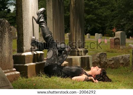 girl in graveyard - stock photo