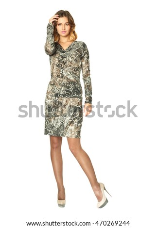 Girl in green dress isolated on white