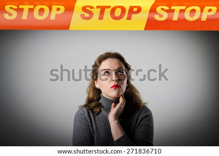 Girl in grey and STOP line over her head. Restricted area concept. - stock photo