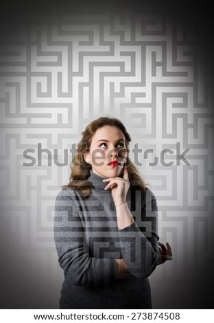 Girl in grey full of doubts and hesitation. Girl looking for the solution. Maze concept. - stock photo