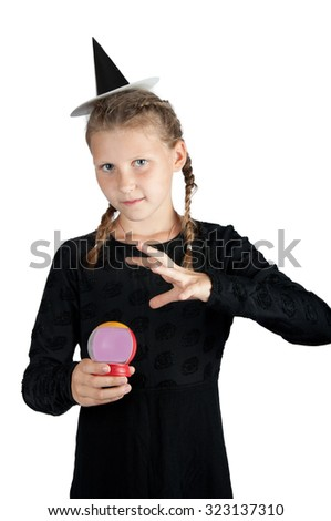 girl in halloween costume of witch with magic ball isolated on white background - stock photo