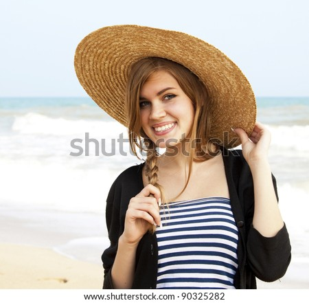 Girl in hat at the sea. - stock photo