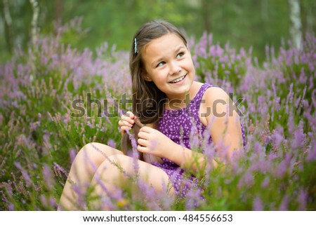 Girl in heather flowers, outdoor shoot