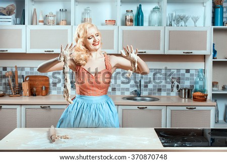 Girl in her arms stuck dough and she was crying. She can not cook dinner. - stock photo