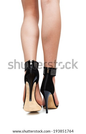 girl in high heels on a white background - stock photo