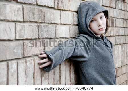 girl in hooded jacket outside - stock photo