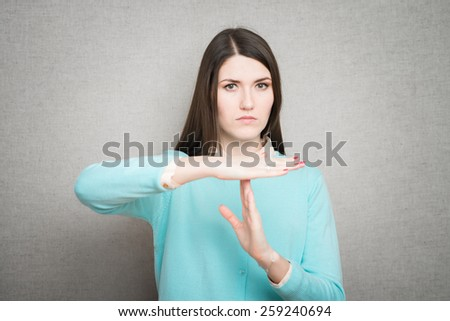 girl in horror and despair scratches his face - stock photo