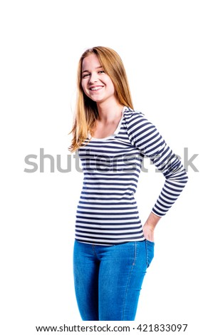 Girl in jeans and t-shirt, young woman, studio shot
