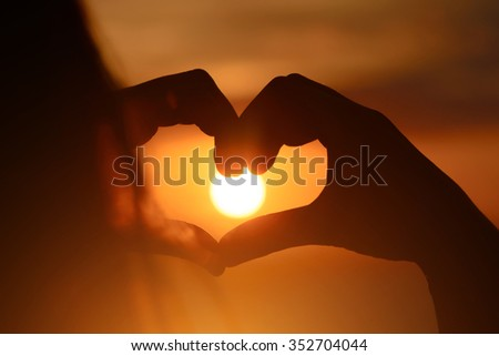 Girl in love enjoying tender moments at sunset during holiday with best friends. Emotional concept of happy exclusive lifestyle moment, sharing time, relaxing with nature contact. - stock photo