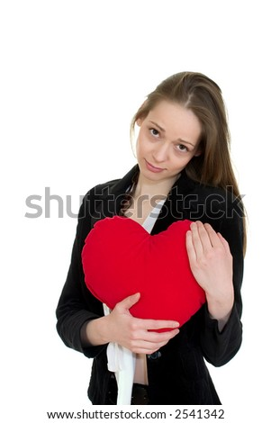 Girl in love hugging a heart shaped pillow