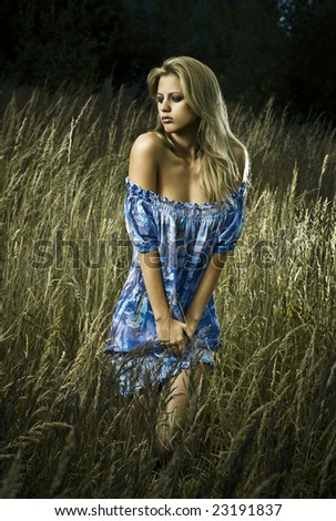 girl in meadow with blue dress - stock photo