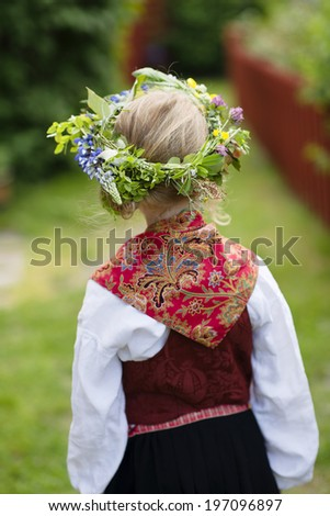 Girl in national costume wearing flower wreath, Sandhamn, Sweden